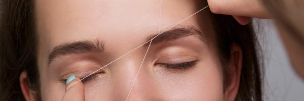 Woman during eyebrow threading