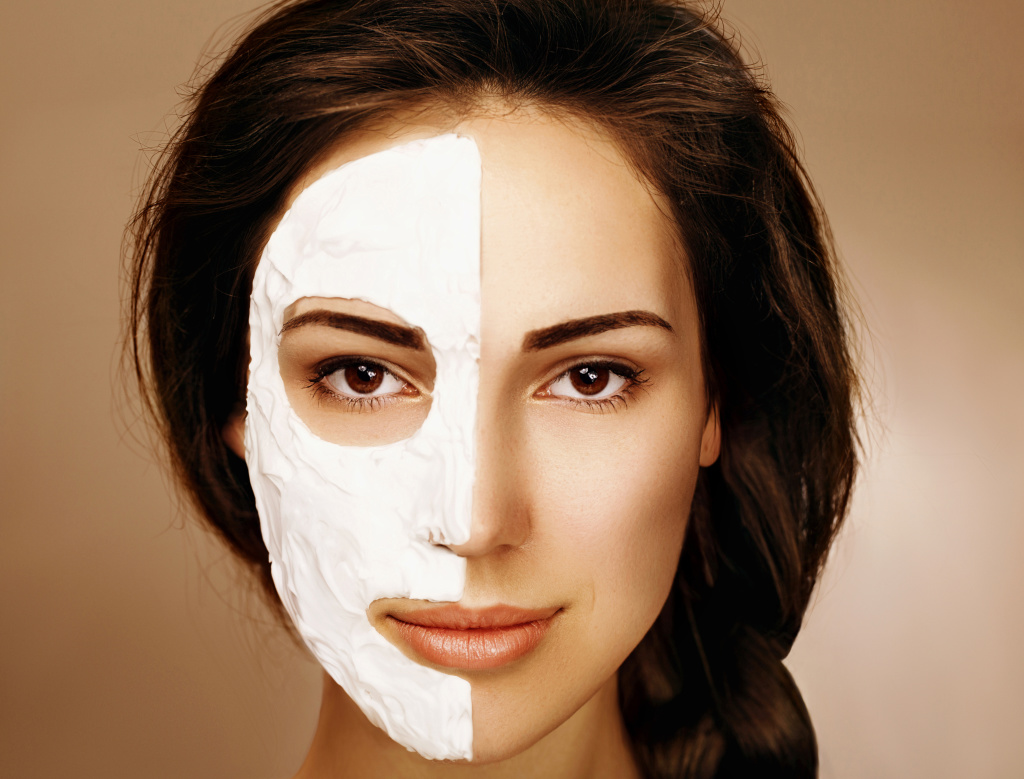 Woman with spa facial mask. Skin care